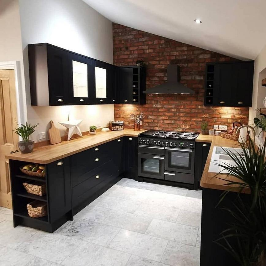 U-shaped kitchen with navy kitchen doors, wooden worktops and glazed wall units