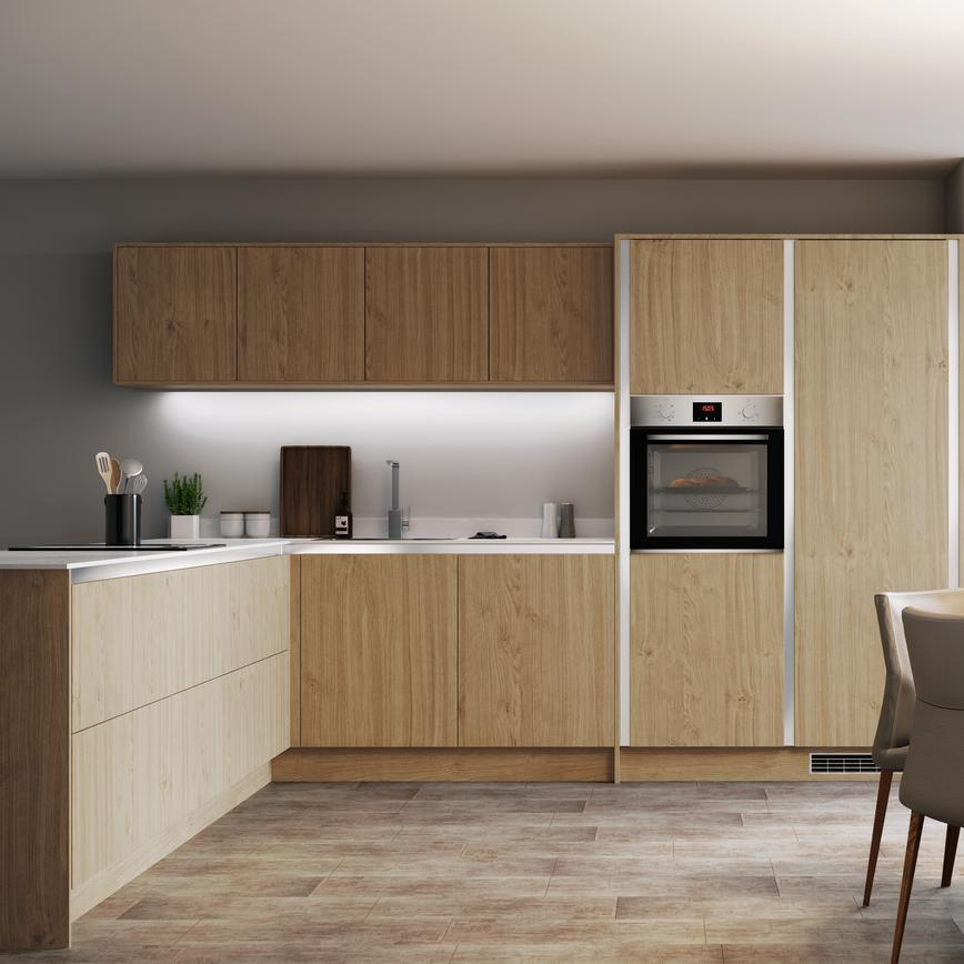Natural oak handleless kitchen with white worktop, single built in oven and round dining table with garden view,