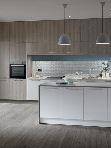 Light grey oak kitchen with floor to ceiling units and contrasting white base cabinets, pendant lighting over kitchen island.