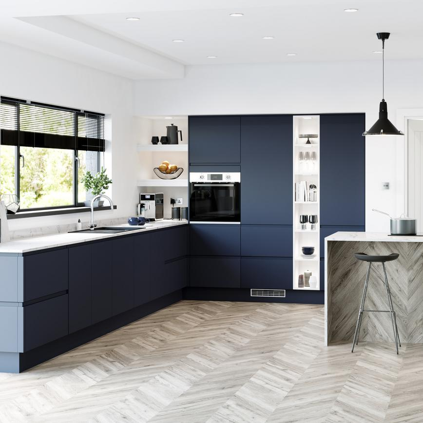 Navy blue handleless super matt kitchen in l shape layout with marble worktop and full height built in open shelving.