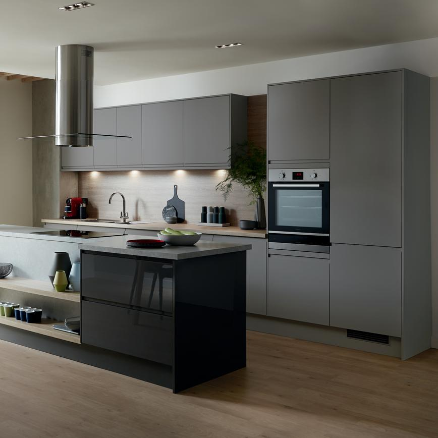 Ultra modern city view apartment with handleless slate grey kitchen and kitchen island with ceiling mounted cooker hood.