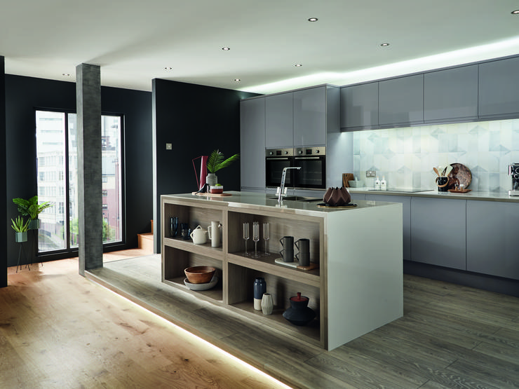 Slate grey modern handleless gloss kitchen in an apartment setting including kitchen island incorporating exposed shelving.