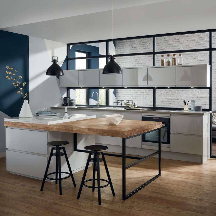 Urban gloss grey kitchen with an island layout, black ironwork and black stools that contrasts the oak worktop and floors.