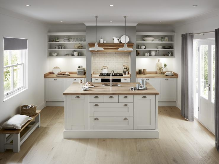 Single wall dove grey shaker kitchen with kitchen island. Framed cooking area with slim kitchen floor cabinets.
