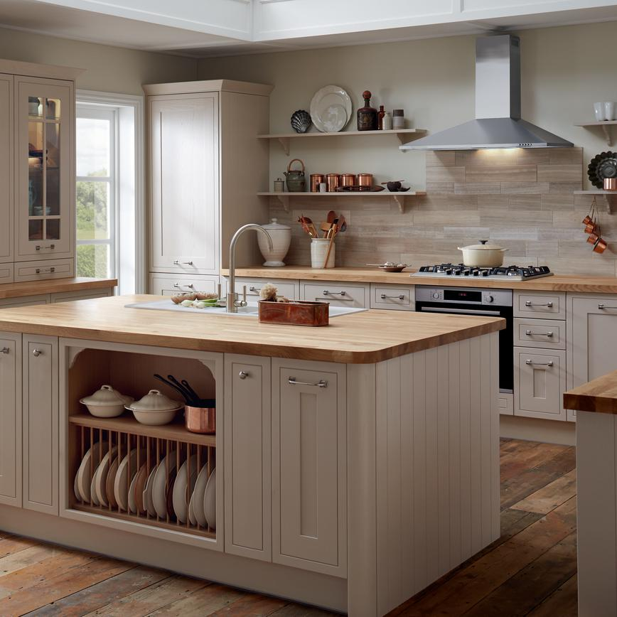 Farmhouse shaker kitchen with open storage in the island unit. Worktop mounted wall cabinets and copper kitchen accessories.