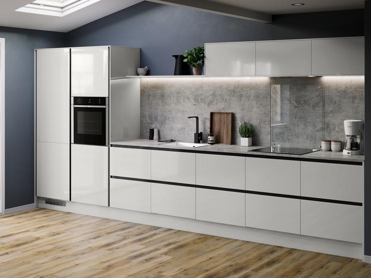 Modern handleless dove grey kitchen with black inserts, industrial grey worktop, black kitchen tap and inset kitchen sink.