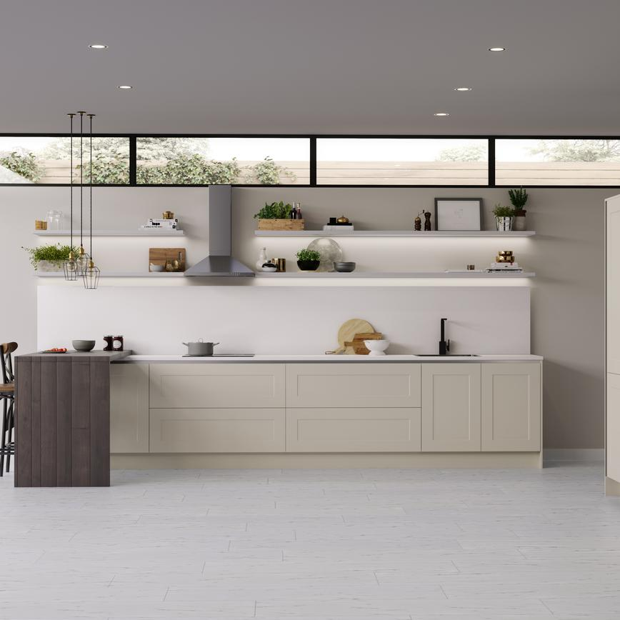 Contemporary ivory cream handleless shaker style kitchen, spacious open wall shelving and breakfast bar.