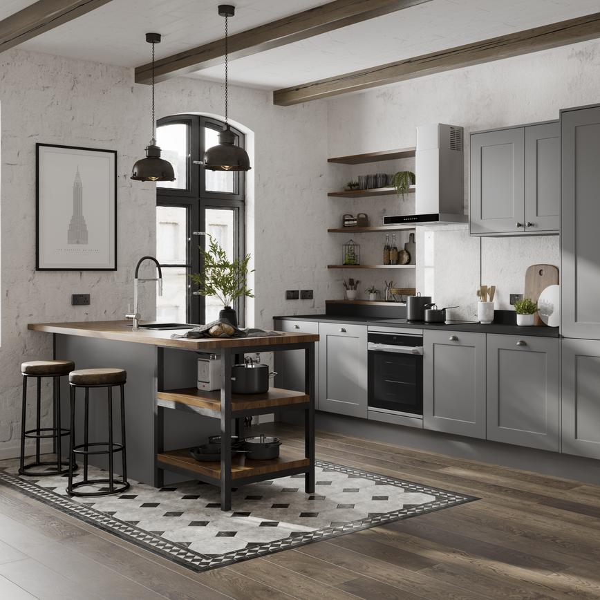 Slate grey shaker kitchen with island style sink and overhanging breakfast bar. Open shelving and exposed white brickwork.
