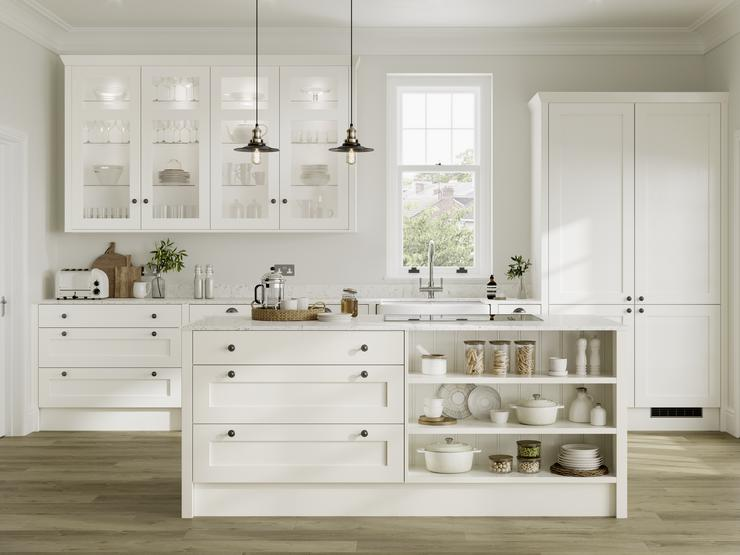 White shaker kitchen idea with island in open-plan layout. Has open shelving, clear glass wall units, and black knob handles.