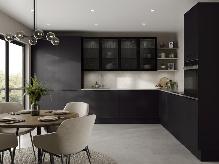 Charcoal black l shape kitchen with geometric wall tiles, glass wall cabinets above a white worktop and chrome kitchen tap.