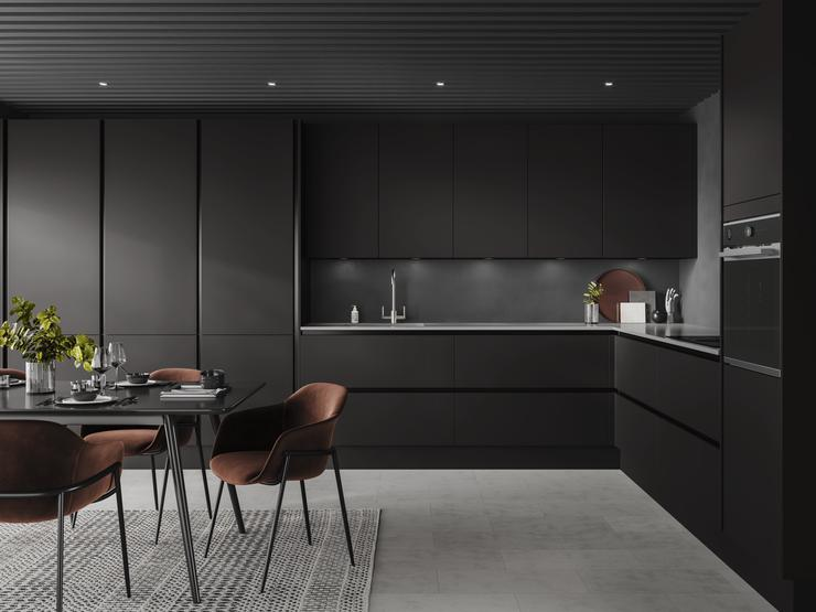 Handleless black kitchen idea using charcoal slab doors and black trims. Includes larders and drawers in a L-shaped layout.