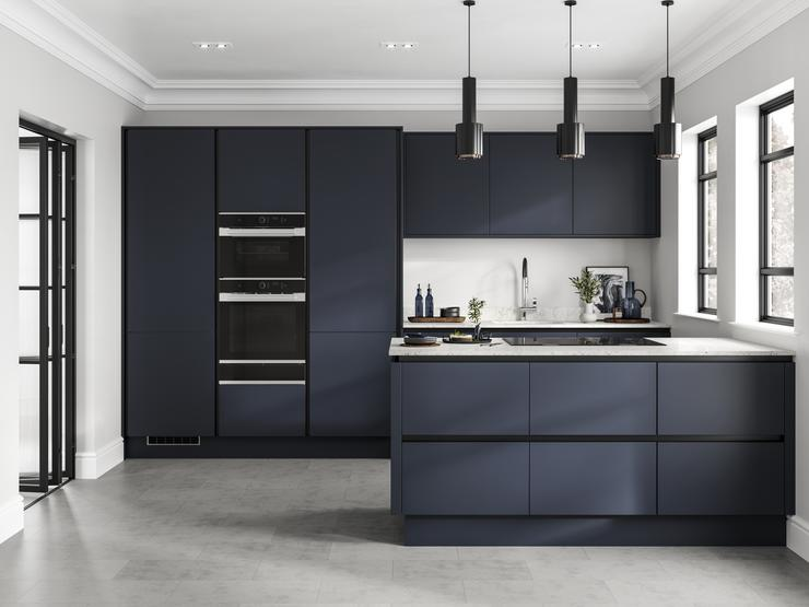 Linear-style navy kitchen with matt-black trims. A galley layout with white worktops, induction hob and built-in double oven.