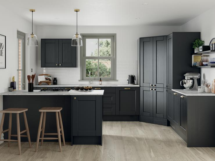 Heritage inspired black charcoal shaker kitchen with exposed brickwork and contrasting white kitchen worktop and flooring.