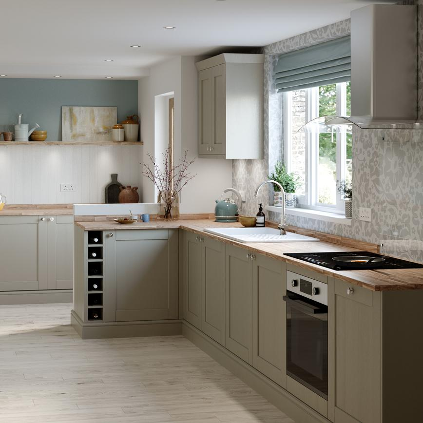 Country cottage style pebble grey shaker kitchen with wood worktop, wall panelling and light grey floral wallpaper.