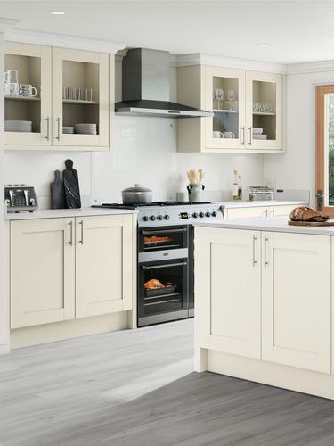 Country style antique white shaker kitchen, grey worktop and ceramic belfast sink. Kitchen island unit with fresh bread.