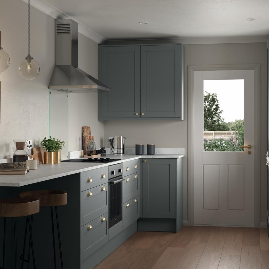 Modern slate grey shaker kitchen in a galley layout with an island kitchen unit incorporating wine rack and breakfast bar.