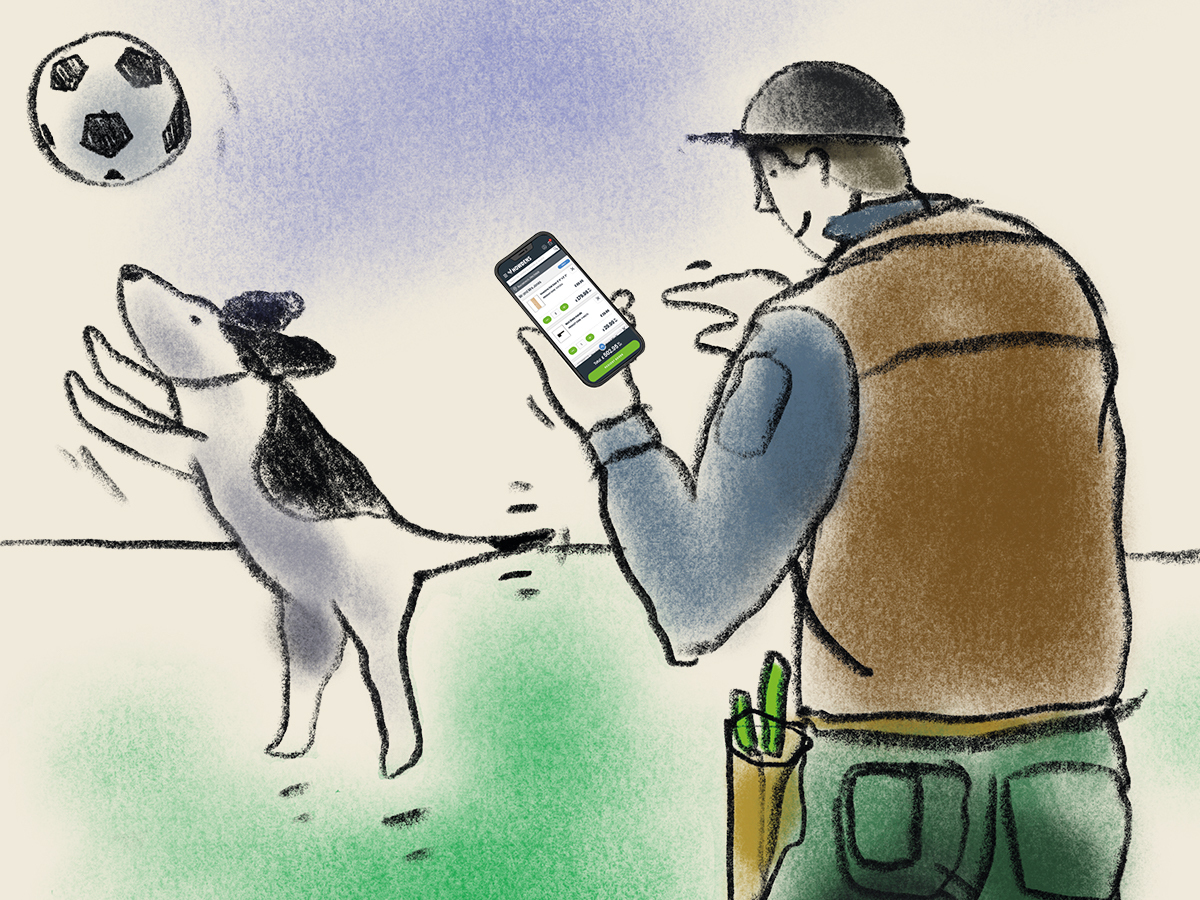 Anytime Ordering - Man placing order on phone while out in the park with his dog.
